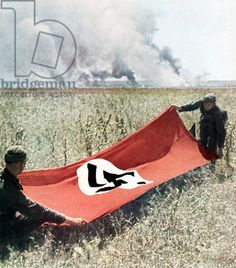Credit: Two Wehrmacht soldiers holding a Swastika flag to protect against friendly fire, Russia, 1942 (photo), German Photographer, (20th century) / © Galerie Bilderwelt / The Bridgeman Art Library