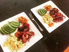 Breakfast of champions. Scrambled eggs bacon avocado grilled tomatoes & a spoon of sauerkraut. Lots of good quality fats & protein to kickstart our Sunday.  by aarontaylor_movementcoach