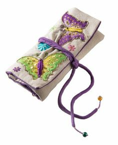 This beautiful purple butterfly jewellery wrap has two zipped pouches, ring bar and bead detail on the ties. They are intricately embroidered by skilled artisans in a small modern workshop near Delhi, India. Workers receive good benefits and pay with good fair trade working conditions in a small family run business. Size 18 x 2 x 25cm £11.97 http://www.amazon.co.uk/dp/B00ITW0DIK/ref=cm_sw_r_pi_dp_98xptb0W2H0PM