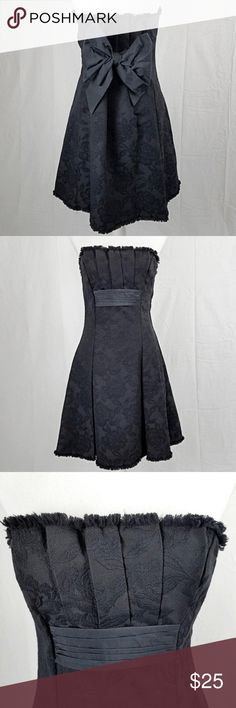 """BCBG Strapless Black Shimmer A-line Bow Dress 4 This fabulous dress by BCBG features an all-over floral motif with just a hint of shimmer. A faux belt accent at the front leads to a glorious bow in back. A-line shape accentuates the waist. Strapless style with a stay-put rubberized band on the inside for no slipping!  Very minor fading to fabric but no holes, stains or flaws.  Color: Black  Style: Strapless A-Line   Tag Size: US Women's 4  Measurements (taken flat)  Chest 16"""" Waist 15.5 Hips…"""