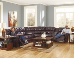 29000-87-77-94 Model Leather and leather match, Motion Sectional, Contemporary, pillow arm, cup holder console recliners on left and right. Quality Leather.