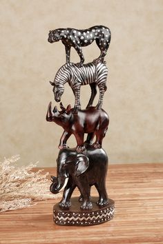 The African Pride Animal Totem Table Sculpture pays homage to the continent's famously diverse and distinctive wildlife. Safari Home Decor, Safari Decorations, Safari Theme, Animal Print Bedding, Animal Print Decor, Animal Totems, Animal Sculptures, Lion Sculpture, Brown Family Rooms