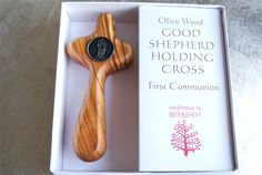 first communion olive wood holding cross