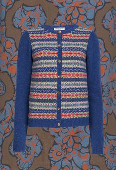 Marilyn Moore home of luxury fair isle cardigans FREDA on Vintage Print background.#fairisle#donegal tweed