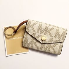 Authentic Michael Kors Vanilla Key Pouch Wallet Excellent used condition. Only carried a couple times. Great for the upcoming Spring and Summer seasons. Has gold hardware. 100% Authentic. Shows very little signs of wear. I don't trade so please do not ask. I only sell on Posh so don't ask if I sell on other sites or take paypal.  Do not ask what my lowest is or comment with an offer price. Michael Kors Accessories Key & Card Holders