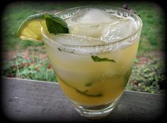 A pineapple basil brewtail is summery and refreshing. A perfect drink to make for chillin' on the deck on a hot day. Pint Glass, Glass Of Milk, Mint Lemonade, Beverages, Drinks, Margarita, Basil, Pineapple, Tableware
