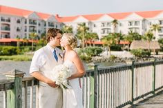 Bride and Groom on the pier at the Charleston Harbor Resort and Marina.  Wedding. photography by: lindseyamiller.com