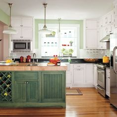 A grayish-green island topped with a 4-inch-thick end-grain maple butcher block complements the painted walls in this complete kitchen redo. | Photo: Helen Norman | See the rest @ thisoldhouse.com
