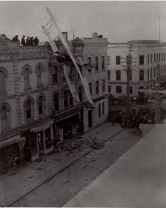 Throwback Thursday! This photograph records the accident when Pilot Cadet Weiss lost control of his plane and crashed into the third floor of a building on the north side of King Street west. Weiss was stationed at Leaside and was flying in C526 on a training exercise when he lost control. After knocking some bricks off the building, the plane became suspended on the hydro wires. The pilot was unhurt (he simply climbed up the wing onto the roof of the building) and the only injury was caused… Three Floor, Knock Knock, Vintage Photos, Louvre, Public, Throwback Thursday, Photo And Video, History, Street