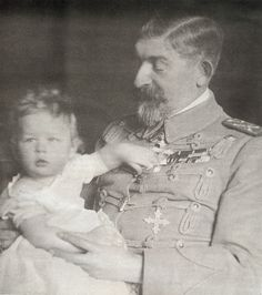 Prince Michael with his grandfather, King Ferdinand I.  When Ferdinand died in 1927 his son, Crown Prince Carol, had left the country and renounced the throne to be with his lover, Elena Lupescu.  Thus Prince Michael became king at the tender age of 5.  A regency council was appointed and was headed by Michael's uncle, Prince Nicholas, who neither wanted nor liked the job.