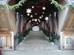 A covered bridge decorated with dozens of illuminated Moravian stars marks the entrance to Old Salem, the Moravian community near Winston-Salem, N.C.