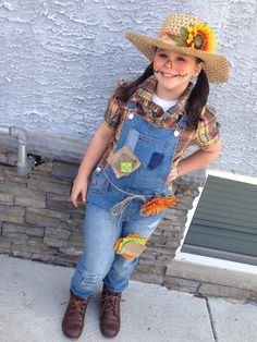 DIY Scarecrow costume, cute makeup and patches. Used a glue gun to attach the patches then safety pinned them on the overalls. Glued the flower on a beach hat I had.