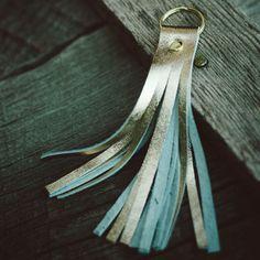 "anne b: gold leather key chain - 5""  $10"