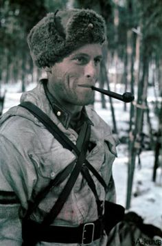 A Finnish infantry Second lieutenant enjoys his pipe tobacco flavor . Constant fighting took soldiers nerves on they limit and tobacco gave .