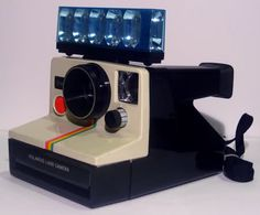 A Polaroid Camera with a Flash Bar!!!                                     Remember back in the day when you not only had to buy lots of film for your camera, you also needed to buy flash bulbs or later  flash cubes or later flash bars? Then eventually someone figured out how to make a permanent (rechargeable) flash bulb built into all cameras. Remember how you wouldn't know whether you captured a great picture or not until you had your film developed somewhere which used to take several days...