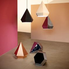 Diamond is a series of lamps each with 12 facets by Sebastian Scherer that play a game of reflections.