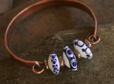Items similar to Lampwork disk and copper bangle bracelet .... Three is not always a crowd on Etsy