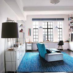 USM Haller sideboard white Light, bright and comfortable living room with a touch of a blue carpet. #shelfie #storage #cabinet #shelf #shelves #cabinets #sideboard #credenza #storagesolutions #shelfies #livingroom #livingroomdesign #interiordesign #furniture #interiors #homedesign #instadesign #interiores #interiorstyling #furnituredesign #homes #interiorinspiration #homeinterior #interiorstyle #interiorinspo #swissmade #USMhaller #usmmodularfurniture #USMfurniture #usmmakeityours