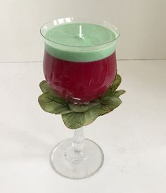 Peach Mango Scented Red and Green Gel Candle with Soy Topping in Clear Pedestal Cocktail Glass With Holiday Leaves Gel Candles, Gold Highlights, Cocktail Glass, Green Leaves, Mango, Candle Holders, Wax, Cocktails, Peach