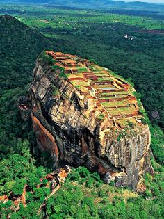 Sigiriya ,Sri Lanka:  King Kasyapa (477 – 495 AD) built his palace on the top of this rock and decorated its sides with colourful frescoes. On a small plateau about halfway up the side of this rock he built a gateway in the form of an enormous lion.   A UNESCO World Heritage Site.