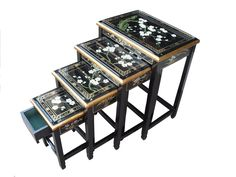 World Menagerie Hand finished nest of 4 tables skillfully hand painted with blossom flowers. Supplied with protective glass tops. Smallest nest has a lined drawer