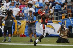 Cleveland Browns running back Duke Johnson makes an end zone catch for a touchdown against the San Diego Chargers during the first half of an NFL football game, Sunday, Oct. 4, 2015, in San Diego.