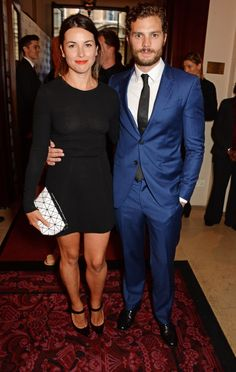 Pin for Later: Is There a Sexier Night Out Than the GQ Men of the Year Awards? Amelia Warner and Jamie Dornan Amelia stuck with a simple LBD, while the man behind Christian Grey stood out in a blue suit.