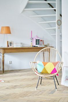 rattan chair + harlequin-patterned pillow!