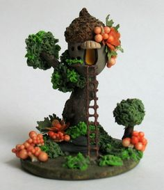 This miniature fairy acorn treehouse sculpture is a one of a kind original design and creation by artist C. Rohal. It is completely hand made,