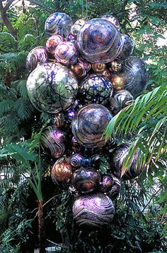 "(L)  DALE CHIHULY   SILVERED PLUM AND COBALT POLYVITRO FLOAT CHANDELIER, 1999   155 x 100 x 72""   ""CHIHULY AT THE CONSERVATORY""   OCTOBER 11, 2003 - JULY 4, 2004   FRANKLIN PARK CONSERVATORY   COLUMBUS, OHIO"