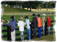 Scarecrows watching a scarecrow football game.