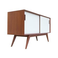Dress up your TV with the slick lines and cool contrast of this hip media center. Its decidedly mid-century air is perfect for a sleek, vintage family room.  Find the Kline Media Unit, as seen in the Danish Modern Meets Desert Calm Collection at http://dotandbo.com/collections/danish-modern-meets-desert-calm?utm_source=pinterest&utm_medium=organic&db_sku=98953
