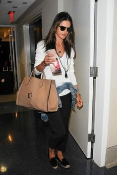 Alessandra Ambrosio wearing Elyse Walker Dee Suede Espadrille Loafer, Nic+Zoe Easy Street Pants and Gucci Jackie Soft Leather Top Handle Bag.
