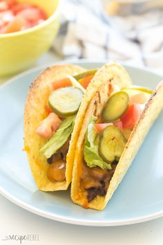 These Cheeseburger Baked Tacos are our new FAVORITE tacos! Filled with barbecue ground beef, cheddar cheese, and topped with all your favorite burger toppings! They're also naturally gluten-free.