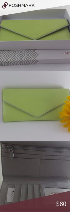 """Lodis  Lime/Dove Audrey Alix Trifold Wallet Lodis   Lime/Dove Audrey Alix Trifold Wallet  7.5"""" x 4"""" x .5"""" - Weight 6 oz  Made out of smooth grain Italian leather.  Long, slim wallet that's chic yet functional with multiple card slots, interior zipper pocket, two interior bill pockets, and an exterior pocket. Snap closure, 10 card slots, 2 interior bill pockets, 1 interior zipper pocket, exterior pocket.  Please feel free to explore the rest of my closet! Lodis Bags Wallets"""