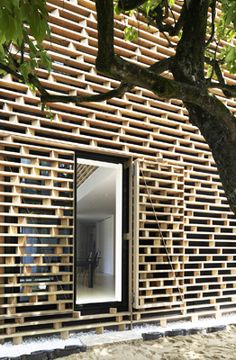 House M by Ae5 Partners in Japan uses wood slat louvers to provide privacy for the inhabitants