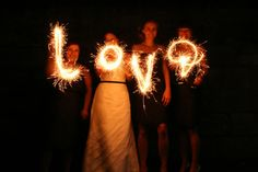 slow down your shutter speed and draw with a sparkler for this effect. also try your flashlight or a glow stick:)