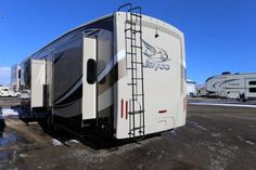 """2016 New Jayco Pinnacle 38 FLSA Fifth Wheel in Montana MT.Recreational Vehicle, rv, 2016 Jayco Pinnacle 38 FLSA, 2016 Jayco Pinnacle 38 FLSA Fifth Wheel, 2016 Jayco Pinnacle 38 FLSA (Front Living Side Aisle) five slide fifth wheel, Espresso interior decor. Plenty of seating in the front living area, sofas on opposing slide outs plus two theater seats for all to enjoy the 60"""" flat screen, center island kitchen with slide out across from dinette on slide out, side aisle bath, rear master king…"""
