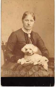 White poodle dog on lap of his lady in fine fashion antique sepia photo cdv card