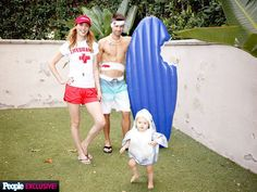 """Such a Treat! Go Inside Eva Amurri Martino's Super-Cute Halloween Party   THE LIFEGUARD, THE SURFER & THE SHARK   Eva Amurri Martino, joined by husband Kyle Martino and daughter Marlowe Mae, organized a party to remember, in honor of Halloween. Seen here in their backyard, the family of three ultimately went with a Jaws-inspired themed costume. """"[Kyle] wanted to do something that was a little more funny or had a little more humor to it so I had to run all the ideas by him,"""" Amurri Martino…"""