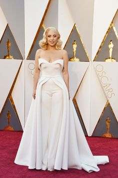 Best Original Song nominee Lady Gaga on the red carpet at the 88th Annual Academy Awards in Hollywood, California - wearing a white Brandon Maxwell pant suit with a long train. #Oscars