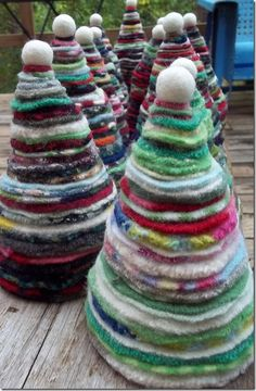 wool sweater circles in 18 graduated sizes wired and topped with a felted ball from Creative Passage