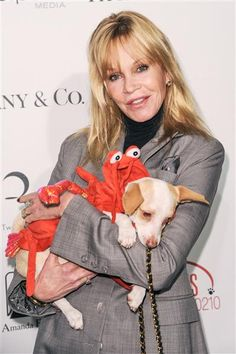 Animal lover Melanie Griffith posed with a costumed dog at the Amanda Foundation's Annual Bow Wow Halloween event in Los Angeles on Oct. 27, 2013.
