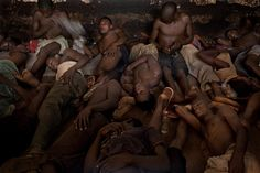 Fernando Moleres & the Empathic Eye – Gallery of photographs from Freetown Central Prison in Sierra Leone. Designed to hold 220 adult #prisoners , the #prison currently houses more than 1300 #inmates , including boys as young as 14. Up to 60 prisoners share a 270-sq. ft. cell for up to 16 hours a day, sharing a bucket as a toilet | Time Lightbox