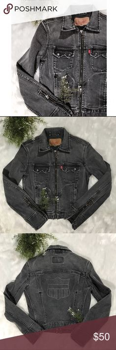 """Levi's}• grey Denim motorcycle fitted jacket Levi's black Denim motorcycle jacket   • in excellent used condition  • studded accents at sleeves  • back decal  • a twist to a classic jacket!  • length 19"""" • chest 17"""" ( laying flat and zipped up)  • sleeve 22.5"""" Levi's Jackets & Coats Jean Jackets"""