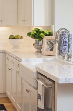 """Kitchen with Thick Countertop"". White Quartzite Countertop Ideas. Kitchen with thick White Quartzite Countertop and farmhouse sink. #WhiteQuartzite #Countertop AGK Design Studio."