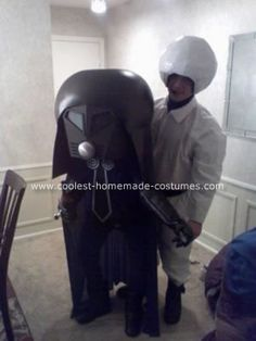Homemade Spaceballs Halloween Costume: This Homemade Spaceballs Halloween Costume took a lot of time to make, especially Lord Dark Helmet's.  Lord Dark Helmet's costume was made out of a witch's