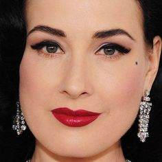Dita von Teese, with her trademark black liquid liner and red lips