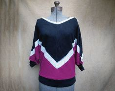 """Black and Maroon V-Neck Sweater with Batwings. Black and Maroon V-Neck Sweater with Batwings, NOS  New Old Stock, Never been worn.  This is an as is item. There is a small run in on side. It can be fixed or contained with the right know how. The run can be seen in first two photos on where the black stripe and white strip meet.  100% Acrylic Made in the USA  Length: 20"""" Waist: 13"""" Chest: 20"""" Neck Width: 9"""" Sleeve to Neck: 25"""""""