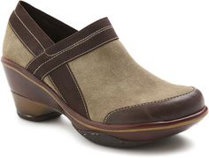 """Cali Classic is a 2 1/2"""" sporty wedge fan favorite. This year-round, easy to slip-on staple will carry you throughout all of your walks in life. Metallic piping and heel detail give this classic the fashion edge you crave."""
